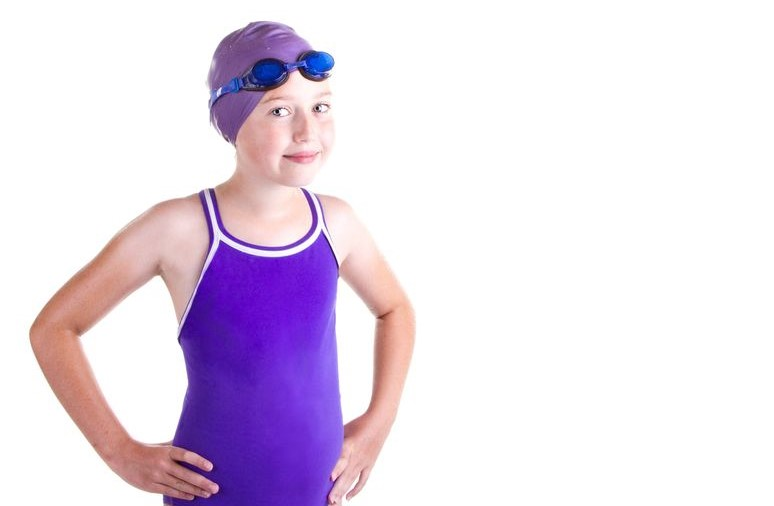 Young female swimmer with goggles