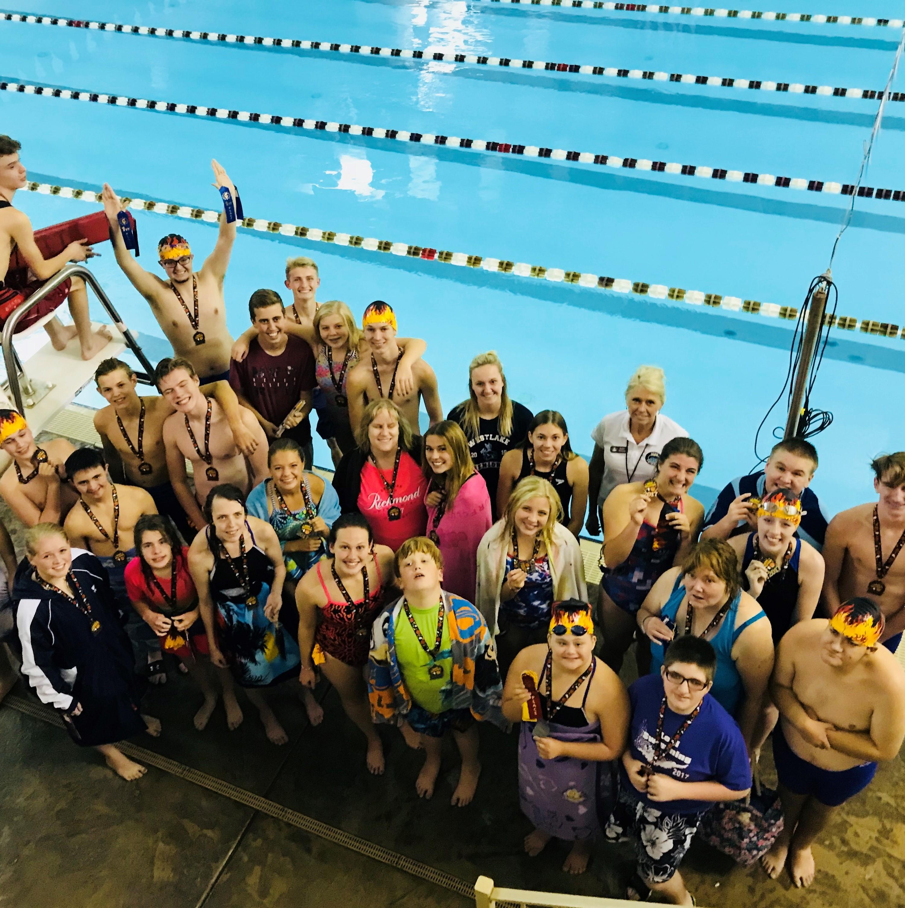 Adaptive swim team participants next to pool