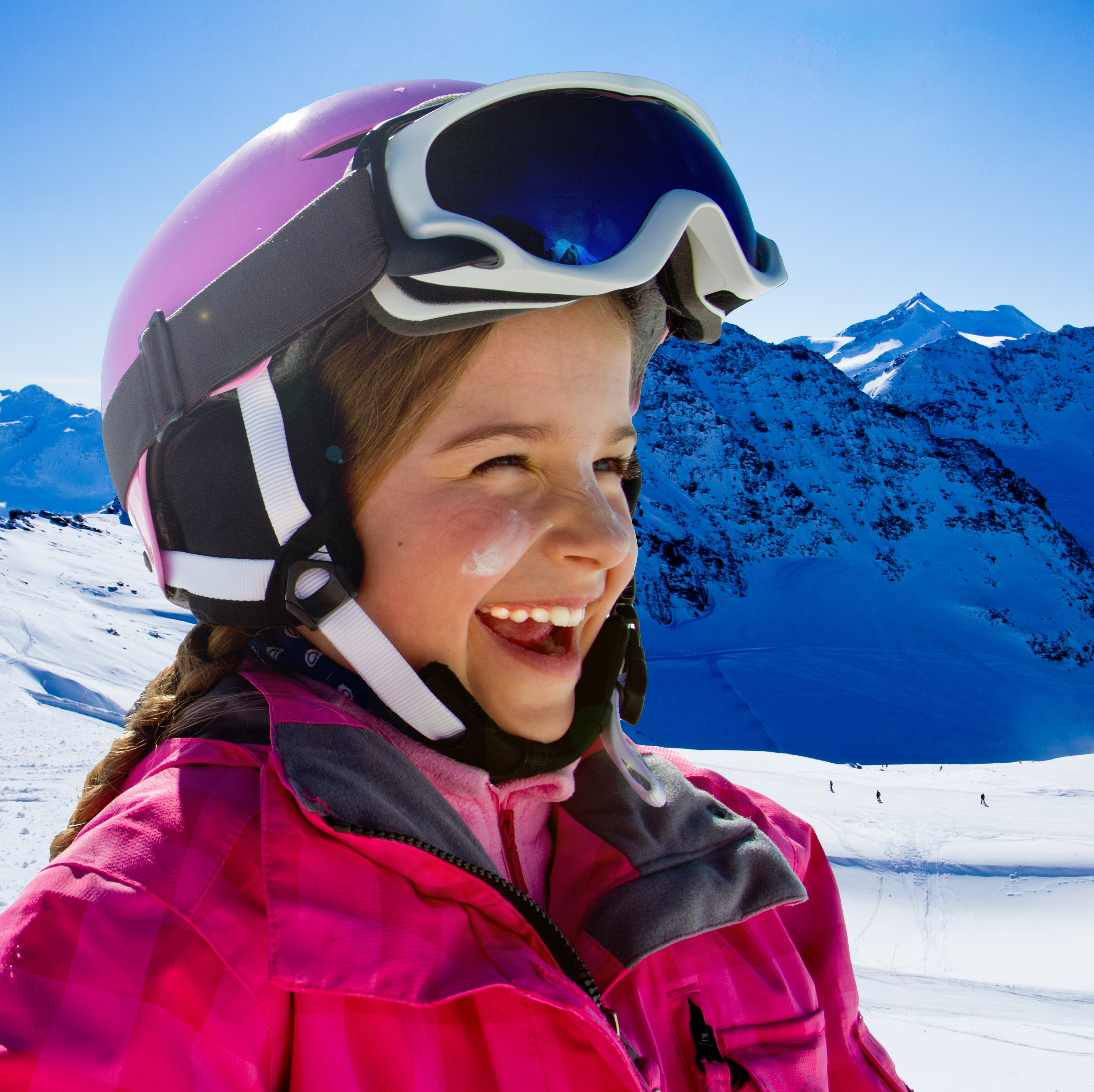 Ski, snow, sun and winter fun - happy young skier