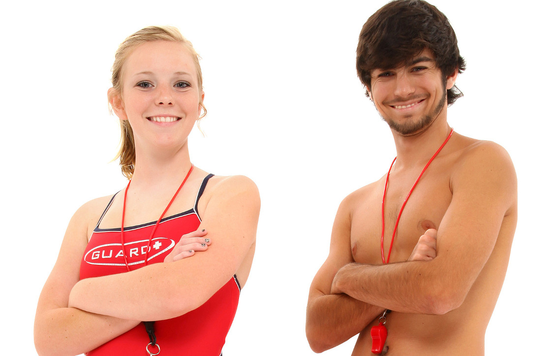 Boy and girl teen lifeguards in uniform over white background smiling with clipping path.