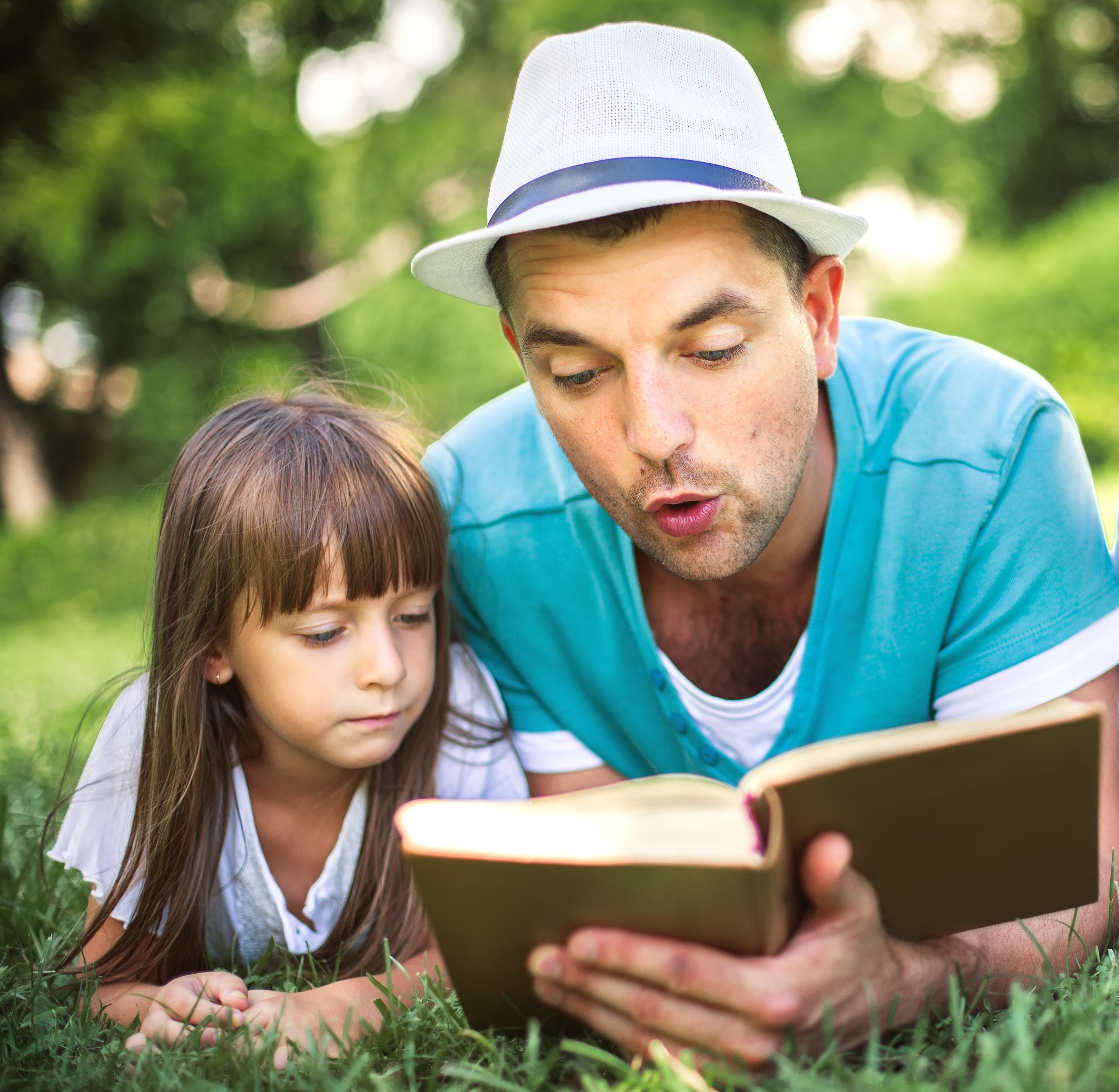 Man reading to girl