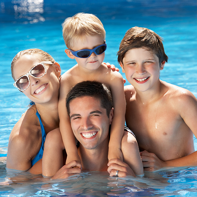Family of four in the pool