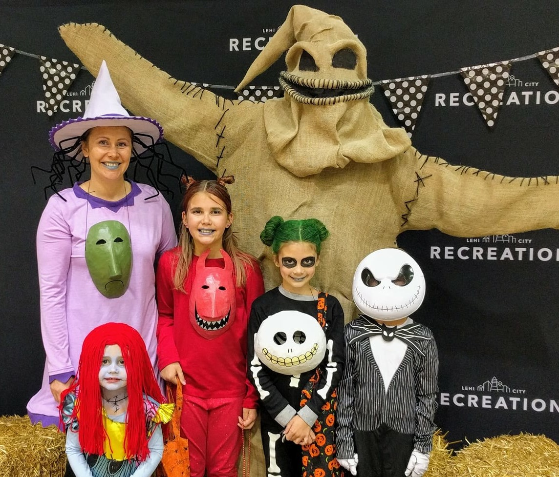 Family at Halloween Extravaganza in Nightmare Before Christmas costumes