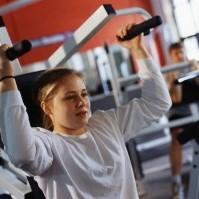 image of woman using shoulder press